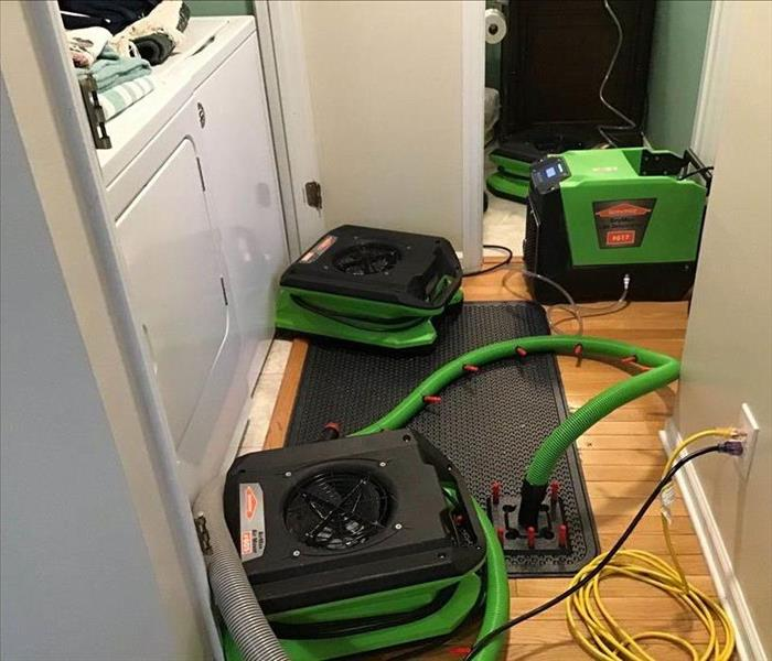 Water damage drying equipment placed in an area that has water damage due to a supply line leak